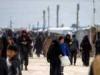 خروج عشرات العائلات السورية من مخيم الهول